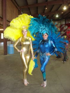 A more conservative take on the Showgirl- bold and beautiful in yellow and blue! feathers, unitards, corporate event, Houston Entertainment Company www.jdentertain.com