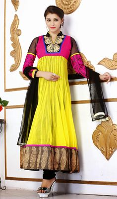 Yellow Pink and Black Net Raw Silk Long Anarkali Suit Glow up like the brightest star with this yellow pink and black net raw silk long Anarkali suit. The lovely resham work a substantial element of this dress. #SilkLongAnarkaliSuit #ChuridarAnarkaliSuits
