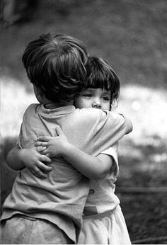 158a79bb7f39 Little boy and girl hugging