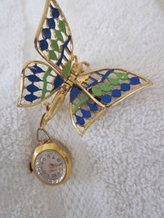 WATCH BROOCH NormanSwiss Butterfly. $350.00, via Etsy.