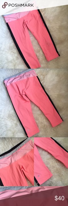 "Lululemon Coral Black Stripe Capri Pants Coral color with light pink stripe and grey stripe at top waistband. Also black stripe on side panels. In great condition, no tears or snags, however at knee area in front there is some black smudge/staining (unsure if can be removed or not, did not try) but it's not too noticeable unless really looking or in glare. Length 26.5"" ❌NO TRADES OR PAYPAL❌ lululemon athletica Pants Capris"