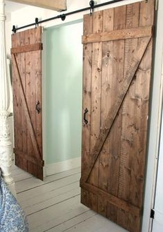 DIY Sliding Barn Door Hardware (galvanized pipes) - hide quilt pinning wall behind barn doors? Sliding Barn Door Hardware, Sliding Doors, Gate Hardware, Door Hinges, Porte Diy, The Doors, Front Doors, Panel Doors, Entry Doors