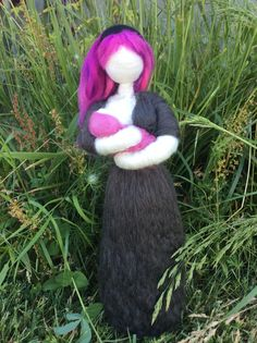 Needle felted nursing momma with pink and purple dreads.