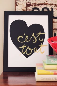 C'est Tout (It's Everything) - Love Screen Print in French (black & gold). $25.00, via Etsy.