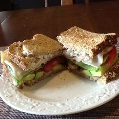 Sandwich with turkey, tomato, lettuce, avocado, and goat cheese. Yum!