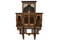 Moroccan hanging cabinet with arched openings and doors. Fretwork inset panels, bone and pearl inlay. Circa 1900.