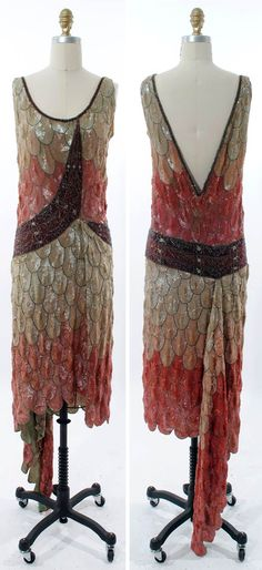 Evening dress, Poiret, circa 1925. Via Decades, Inc. Love the one long godet insert in the back as well as the deep V back with the triangle going the opposite direction in the front.
