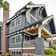 Its slate blue color on the walls, white trim, and red brick accents has given it an awe-striking appearance. The slate blue color imparts quiet, understated elegance while the white trim highlights the architecture.