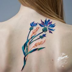 Floral tattoo in blues