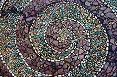 Sidewalk mosaic in east side Vancouver downtown.  Photo: Cassie