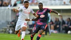 Bordeaux's Maxime Poundje (right) vies with Liverpool's Jordon Ibe