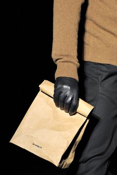 10 Ways to Carry Home That 916-Page September Vogue Without Looking Silly: Jil Sander paper bag: If you use this $290 Jil Sander paper bag (yes, it's really made of paper) to carry home your Vogue in, you pretty much win at life.