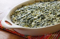 Skinnytaste hot spinach and artichoke dip. Low in fat but still delicious. Love to dip carrot sticks in spinach artichoke dip.