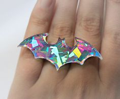 "Holographic Gem Batman Ring ""Holographic laser cut acrylic ring on silver plated adjustable ring base. Batman Ring, Hearly Quinn, Laser Cut Acrylic, Pastel Goth, Latest Fashion For Women, Look Fashion, Fashion Necklace, Jewelry Accessories, Cheap Jewelry"