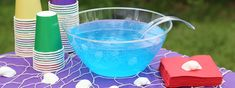 Seawater Punch - Hosting a backyard luau, mermaid-themed birthday party, pool party, or boy baby shower? Serve your guests a festive blue drink that's easy to make with only three ingredients from Dollar Tree. When displayed in a clear punch bowl, sunlight illuminates the punch, making you feel like you're relaxing near the tropical waters of the Caribbean — an inexpensive way to feel like you're in the islands.