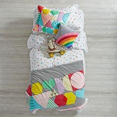 Classic 80's style comes to life with our exclusive Rainbow Charm Bedding. Designed just for us by Ampersand Design Studio, this colorful and retro bedding set features a combination of bright vibrant shapes and playful patterns. Also available in Crib Bedding and Toddler Bedding.