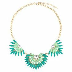 """Add a pop of style to evening ensembles and work outfits alike with this stunning gold-plated necklace, showcasing a bib of teal beading and shimmering rhinestones in fan-inspired silhouettes.   Product: NecklaceConstruction Material: Zinc alloy, resin and rhinestonesColor: Teal and goldFeatures:  Adjustable chain length adds up to 2.75""""Fan-inspired silhouettesHandmade   Dimensions: Chain: 18.5""""Stones: 2"""" H x 7"""" WCleaning and Care: Avoid all oils and chemicals (such as lotions, hairspray…"""
