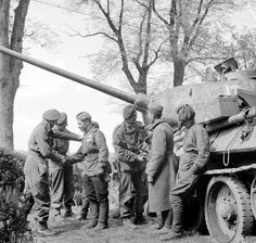 Men of the British 6th Airborne Division greet the crew of a Russian T-34 tank near Wismar, 1945.