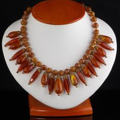 Beautiful vintage beads on this necklace. Stunning with gold or brown low cut blouse or dress.
