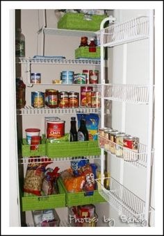 Wire shelves in the door to store cans
