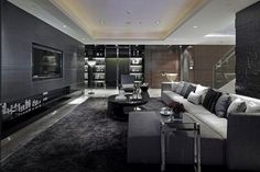 Luxurious-Living-Room-Design-with-Black-Grey-Furniture-and-Grey-Tiles-on-Walls-by-Steve-Leung.jpg (600×400)