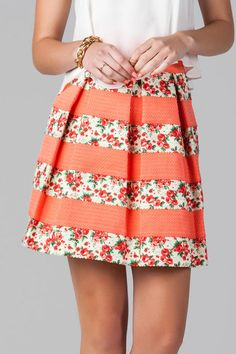 """Our favorite bandaged skirt gets a sweet update!  Dainty roses grace this bandaged skirt with contrasting coral stripes.  Style with a simple chiffon tank & wedges for a finished look.    <br><br>   -17"""" length<br> -34"""" waist<br> -Measured from a small<br><br> -100% Polyester<br> -Hand Wash<br> -Imported<br>"""