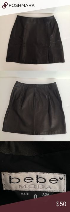 "[bebe] Black Leather Mini Skirt, Size 0, NWOT bebe Black Leather Mini Skirt, Size 0, NWOT  * Fully lined * Front leg slit * Back zip * Shell:  100% Leather  * Lining:  100% Acetate * Leather clean only * Style 3553 * Made in Canada  Measurements (all approx.) taken w/ garment flat and unstretched: 13 5/8"" waist (seam to seam) 17 1/2"" hip (seam to seam) 14 3/4""L (waist to hem) 4 3/4"" front leg slit  🚫Trades🚫 🚫No Modeling🚫 ✅Please ask questions prior to purchasing. ✅Same day shipping if…"