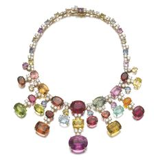 GEM SET AND DIAMOND NECKLACE, MICHELE DELLA VALLE Of fringe design set with variously cut gemstones including tourmaline, aquamarine, heliodor and peridot, highlighted with brilliant-cut diamonds