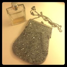 Vintage sequined purse Cute vintage purse from a random boutique. 6 inches tall, 5 inches wide, and chain is about 20 inches long. Silvery lavender color with sequins. Very cute to dress up any outfit! Tristan Bags