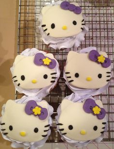Hello Kitty cupcake:  Hello Kitty made from fondant, whipped frosting tinted violet on a butter golden cup cake.