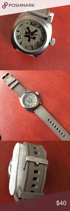 Zoo York Watch Men's Zoo York analog watch, stainless steel back, gunmetal case with gray silicone band. Signs of wear, scratches on face, see third photo. No longer have original box. **NEEDS BATTERY ** Zoo York Accessories Watches