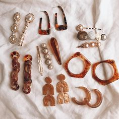 "5a2c6eff7b0 The Outlier Standard • on Instagram: ""Warm hues for your lobes & Intricate  barrettes for your locks. Link in bio"""