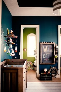 Though I'm not usually a fan of dark bold colors, I love how this design just seems to work well for a nursery! Wow!