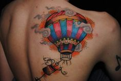 I want a hot air balloon right above the globe on my ankle