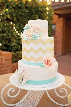 Adding a pattern to your cake is a fabulous way to add 10 cups of personality to your day. Chevron is still a wedding winner, or you might like to play with some lesser-used patterns: herringbone, polygons/hexagons, tribal or ikat. Kate Jeppson Photography #weddingcake #utahvalleybride