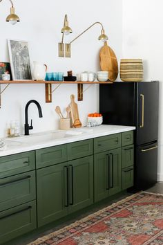 Last week we posted our studio kitchenette reveal and everyone had so many questions about our DIY black fridge with the brass pulls! When we started planning out our studio kitchen design we fell i Green Cabinets, Green Kitchen Cabinets, Home Kitchens, New Kitchen Cabinets, Kitchen Design, Diy Kitchen, Kitchen Remodel, Budget Friendly Kitchen Renovation, Studio Kitchen