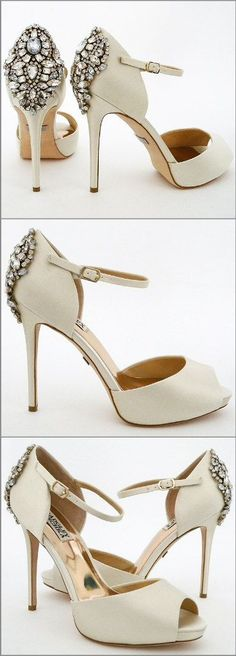 "Badgley Mischka wedding shoes. A favorite has returned better than ever! Dawn offers vintage glam at it's best in a classic ivory shade. Peep toe, ankle strap, on a 4"" heel finished with a fabulous sparkling ornament at the back."