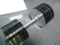 Amy wrote in about Danny Seo's project where he turned old cds into dumbbells. No tools are required and with just 150 CDs, a threaded rod and bolts you ca