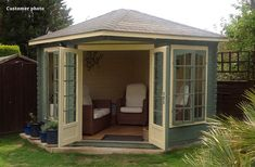 If a summer house has lots of windows it's important to link the exterior and interior colour schemes together. This Lovat summer house (available from GardenLife for just £1710) has a clean interior that is largely cream, but the exterior green stain (which is darker) adds both contrast and colour.