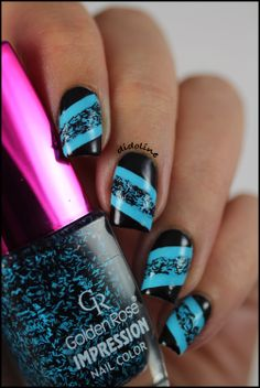 Diagonal turquoise blue and black mani!!!  I love this interesting use of bar glitter in this design!!!