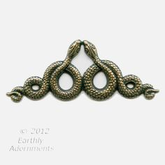 Oxidized brass double serpent stamping.  68x26mm.  The back is the hollow reverse of the front. Sold individually.