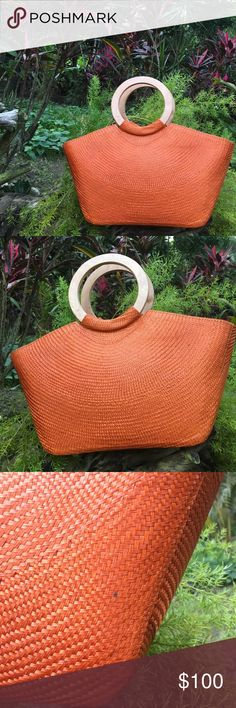 Orange Buntal Round Wooden Handle Tote Handbag - Handmade Buntal tote.  Made in the 🇵🇭 - Round Wooden handle - Lined w/ 2 smart phone pockets - Silver hardware - Zipper closure   Ask ALL questions before buying, sales are final. I try to describe the items I sell as accurately as I can but if I missed something, please let me know FIRST so we can resolve it before you leave < 5🌟rating.   🚫TRADES/OFFLINE TRANSACTIONS/SPAM ✅Use OFFER BUTTON (Please consider the 20% PM fee) 🛍Bundle your…