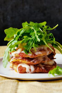 Corn Cake Stacks with Aged Cheddar and Arugula  - CountryLiving.com