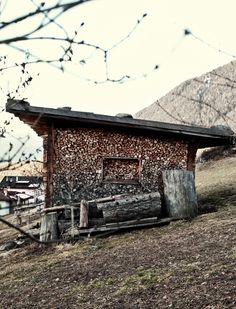wooden wood shed with wood