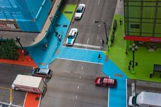 """Multimedia artist Jessica Stockholder is behind this fun installation which is a three-dimensional homage to fabric artist Christo and commissioned by the Chicago Loop Alliance's Art Loop. The idea is to create """"a cubic volume of color in the intersection wedged between four corners and four buildings"""" or to make one feel like they've stepped into an animated film."""