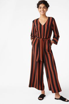 A v-necked jumpsuit with a flowy feel 'n' oversized cut. Tie a bow and you're good to go 3 In a size small the waist width is 67 cm and the inseam is 64 cm