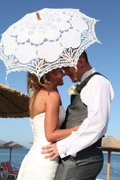 a secret kiss captured!  Kylie and Mike in Kardamena, Kos.  www.weddingsinkos.com
