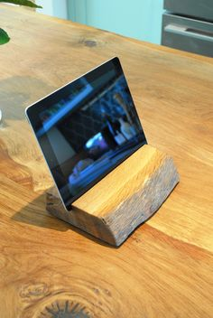 wooden ipad stand made from an oak offcut with a waney edge. #Woodenipadstand #ipad #ipadholder #tabletholder #tablet #rustic #ipadmini #kindle #ipadstand #woodengift #ipadholders #lethbridgelinesjoinery #bespokejoinery #bespokecabinetry #waneyedge
