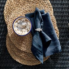 "Textural woven round placemat of hand-braided abaca delivers an earthy yet sophisticated presence to your table. The durable fiber grows in abundance in the Philippines. Lightweight 100% linen napkin is pre-washed for extra softness and tailor finished with a 1.5"" hem and mitered corners."