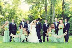 A gorgeous wedding group- we love the mint and signage! By @Vanessa Joy Photography